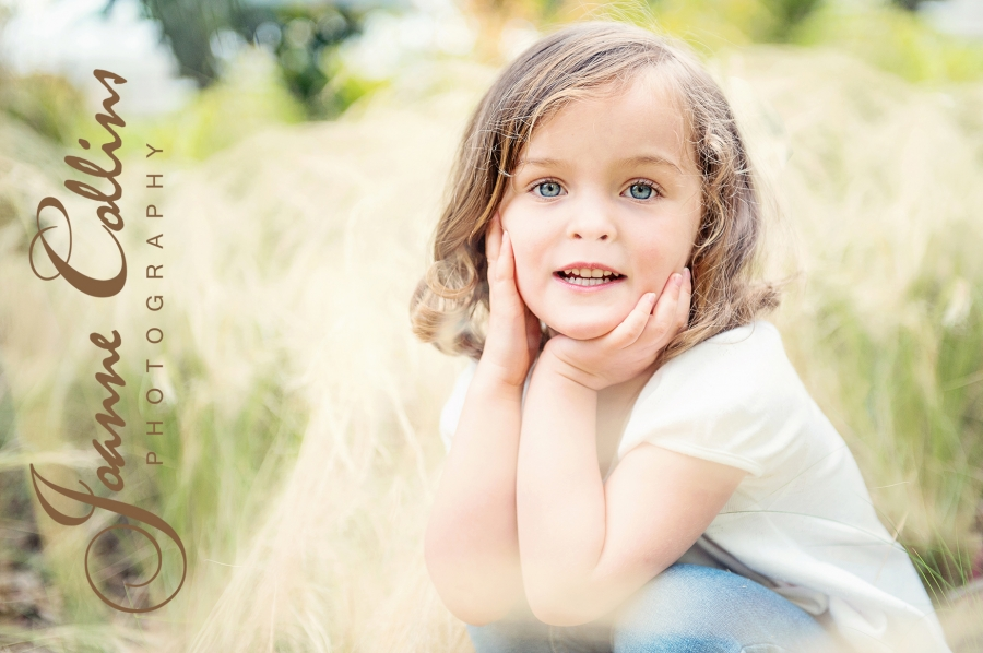 on location photographer maidstone kent twins at mote park cute twin with head in hands