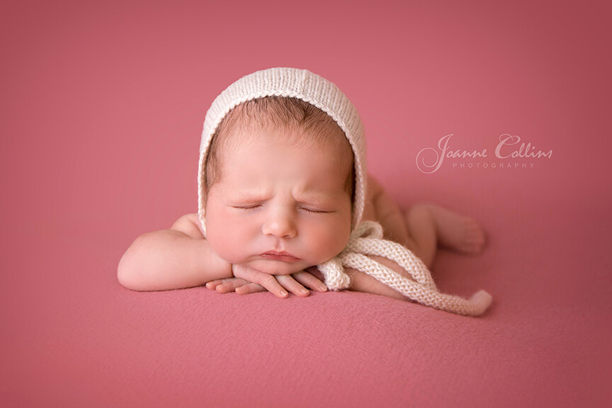 Baby Photographer Crowborough Kent 8 days old baby girl in cream bonnet