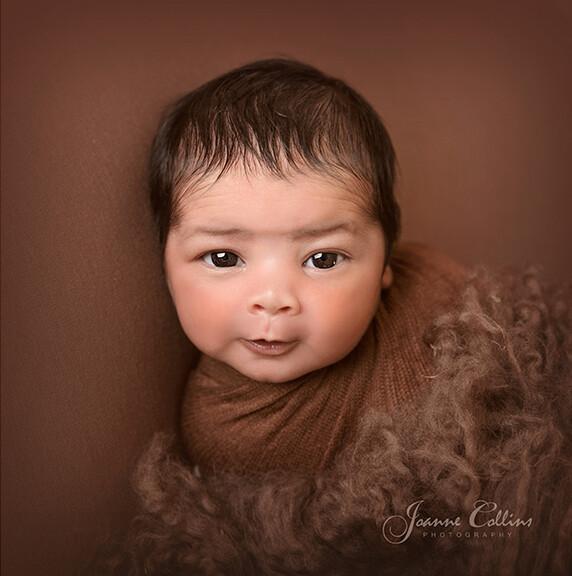 newborn photo baby boy with eyes open