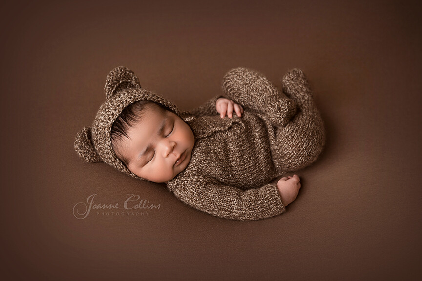 Newborn Baby Photographer Rochester in teddy outfit