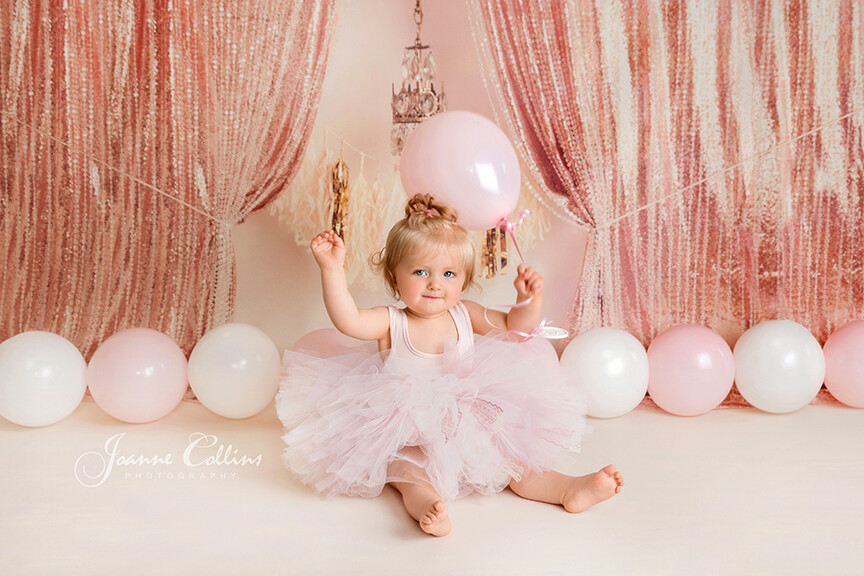 girls first birthday pink photoshoot with balloons