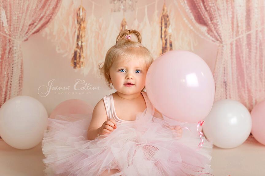 first birthday photoshoot Tunbridge Wells. 1 year old girl pink backdrop