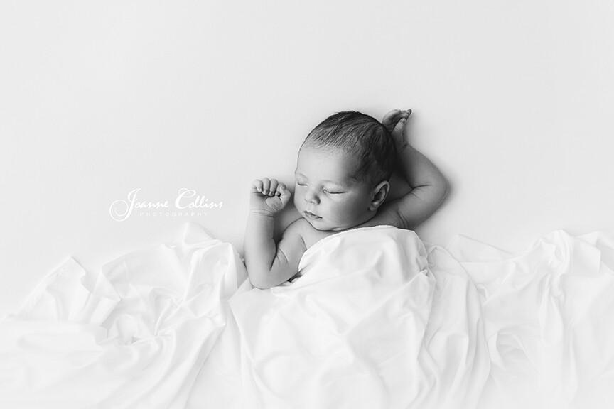 newborn baby girl black and white photo