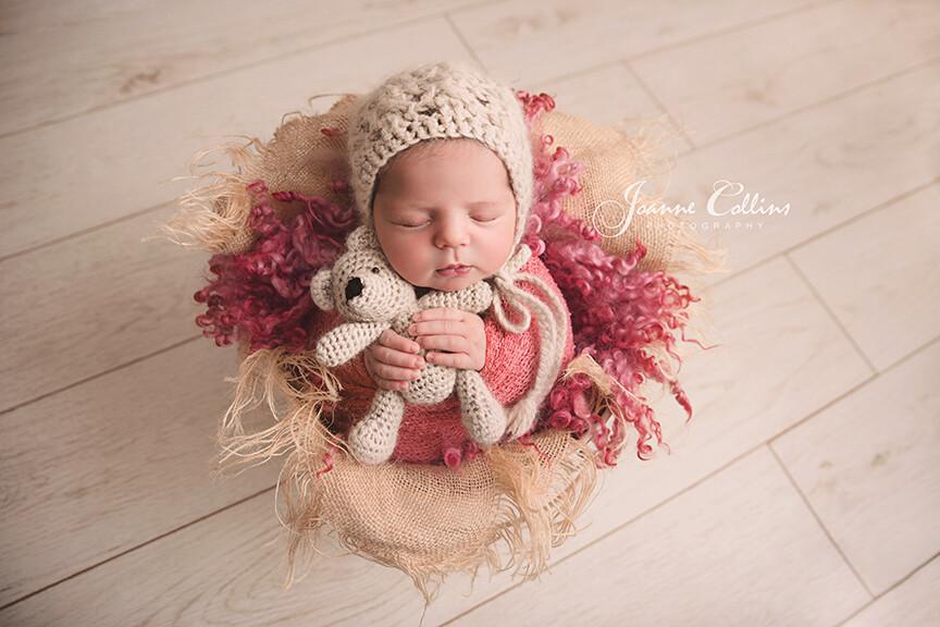 newborn baby girl 8 days cuddling teddy. Joanne Collins Photography.